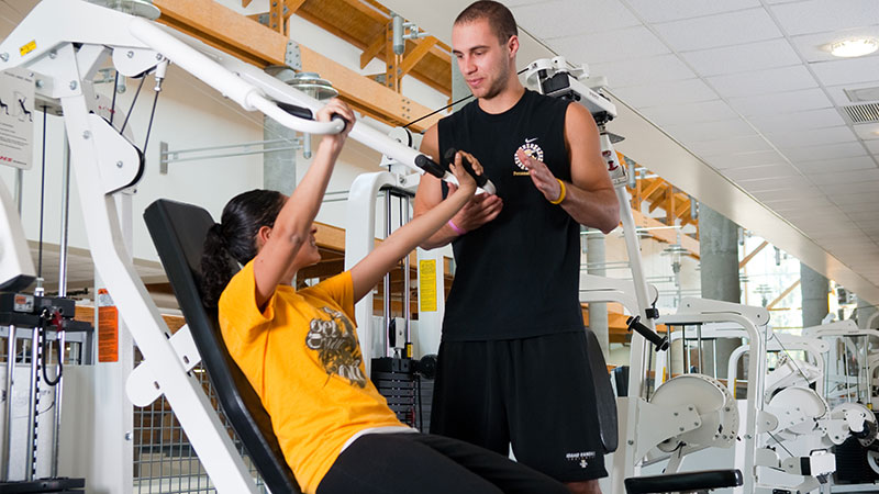 Trainer working at an athletic center