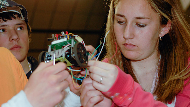 University of Idaho students working on the electrical components of a small motor