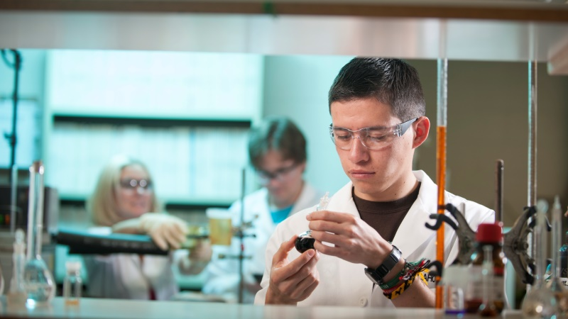 A Chemical Engineering student works on a project similar to those done in labs by undergraduate students at the University of Idaho