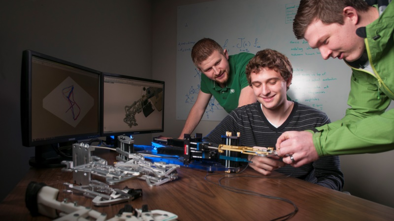 University of Idaho students in a mechanical engineering robotics lab, both graduate and undergraduate students get hands-on experience at UI.