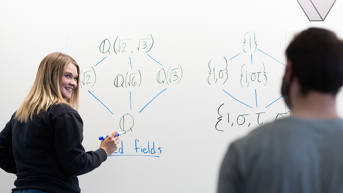 Mathematics student illustrates a mathematical equation at the University of Idaho.