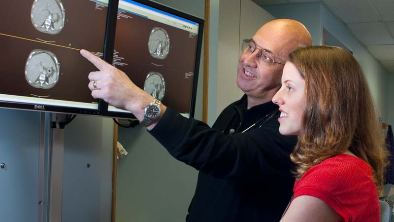 A medical physician discussion a patients brain scans in a hospital.
