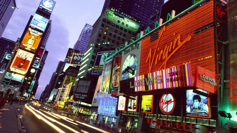 Advertisements designed by marketing firms line the streets of New York City.
