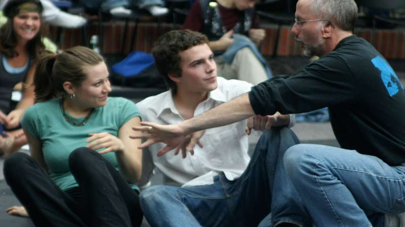 Performance faculty member David Lee-Painter working with acting students