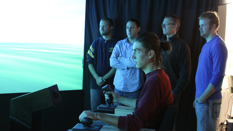 Students conducting an experiemnt in the Human Factors flight simulator