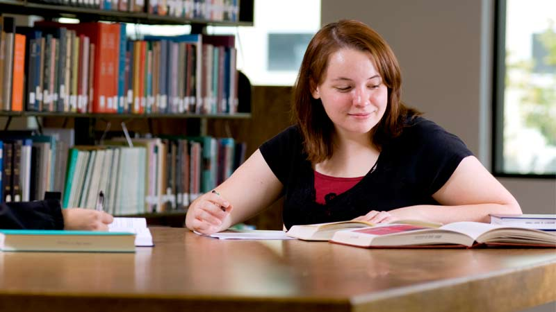 English graduate student studying in the University of Idaho campus library