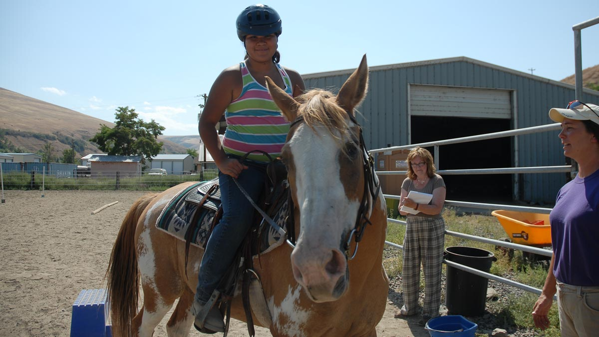Child on a horse participating in the 4-H horsemanship program