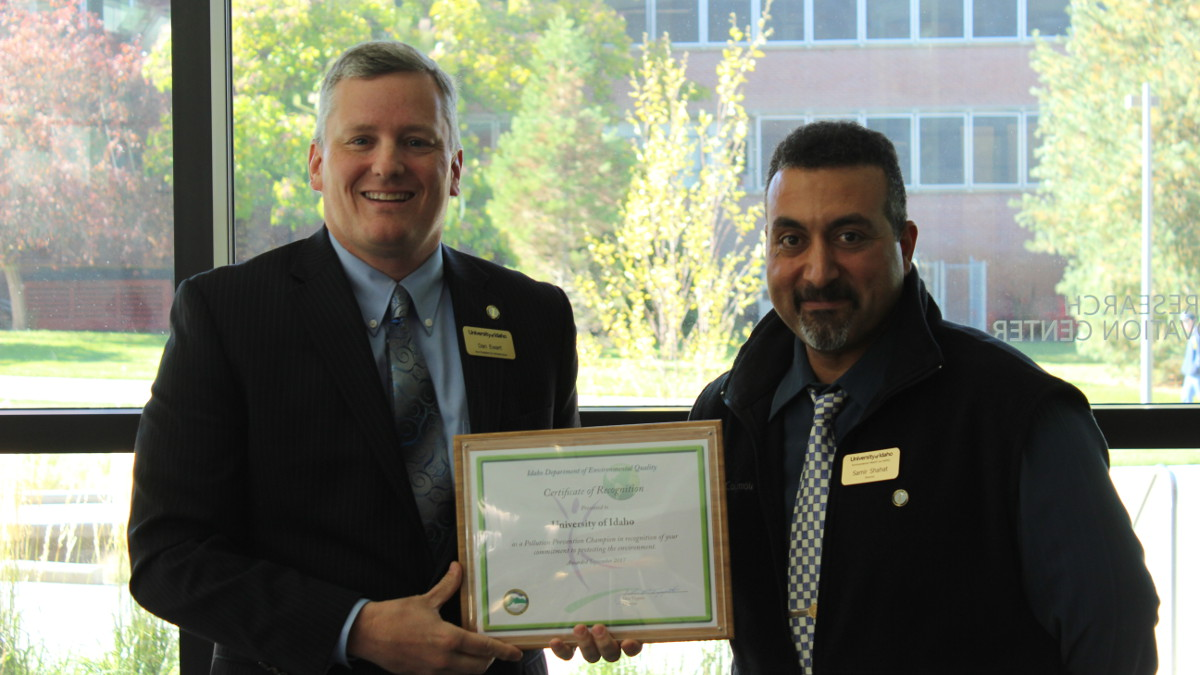 VP of Infrastructure Dan Ewart and Director of Environmental Health and Safety Samir Shahat display the 2017 Pollution Prevention Champion award