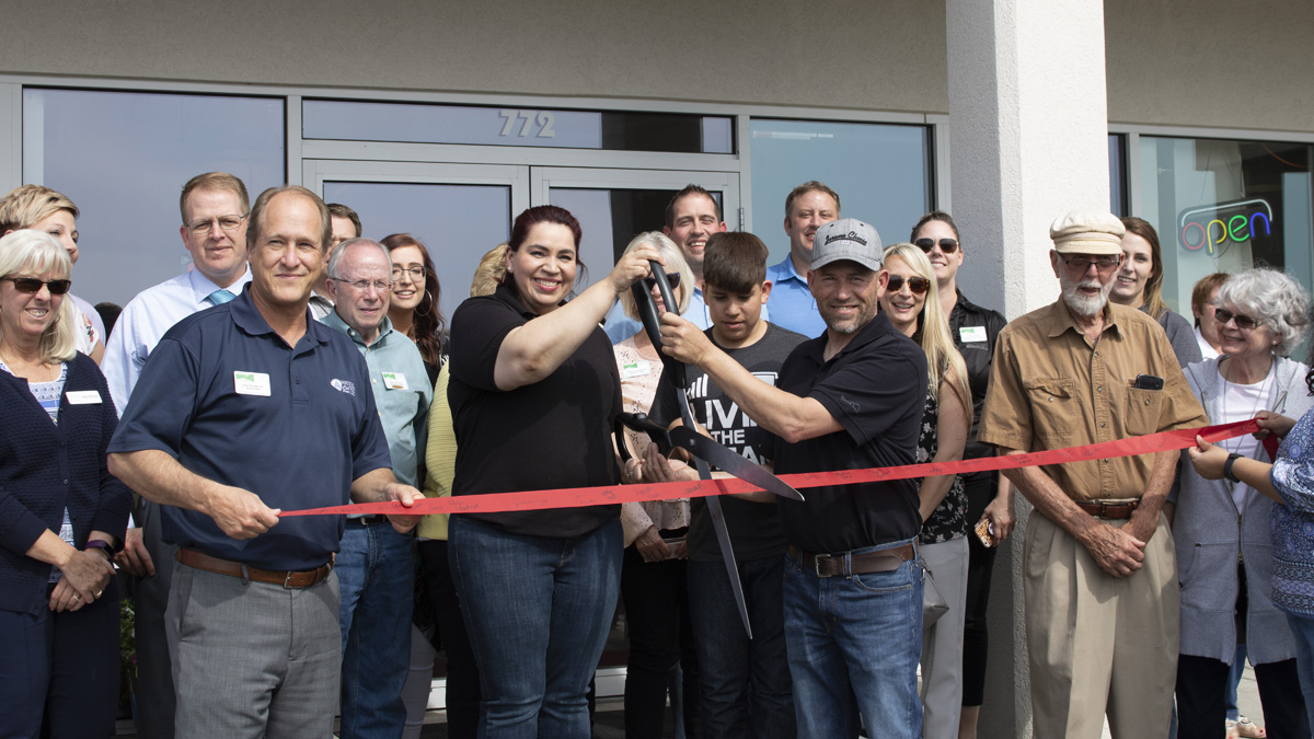 Ribbon cutting on a new business.