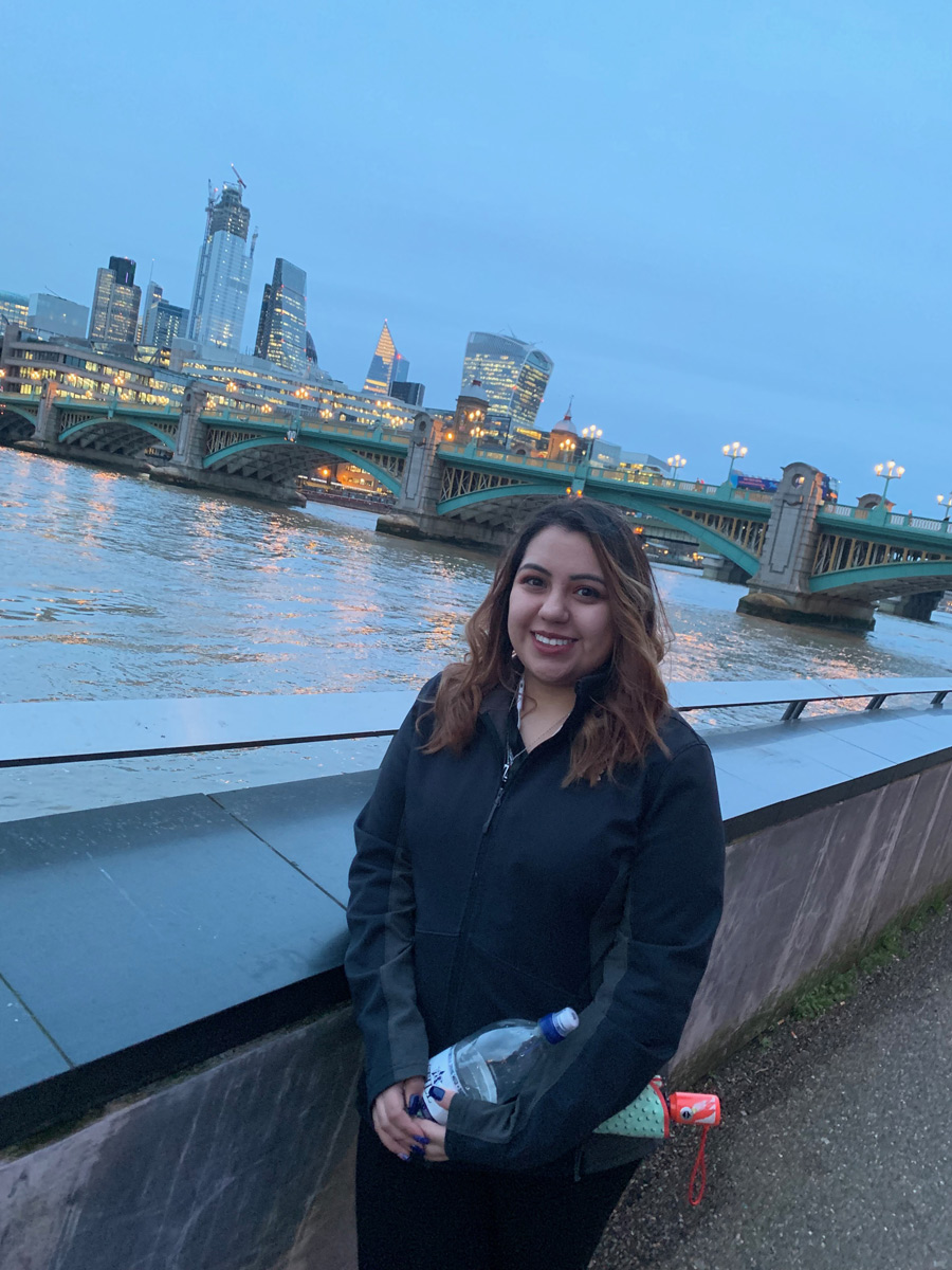 Saydie Garcia in London with the River Thames in the background