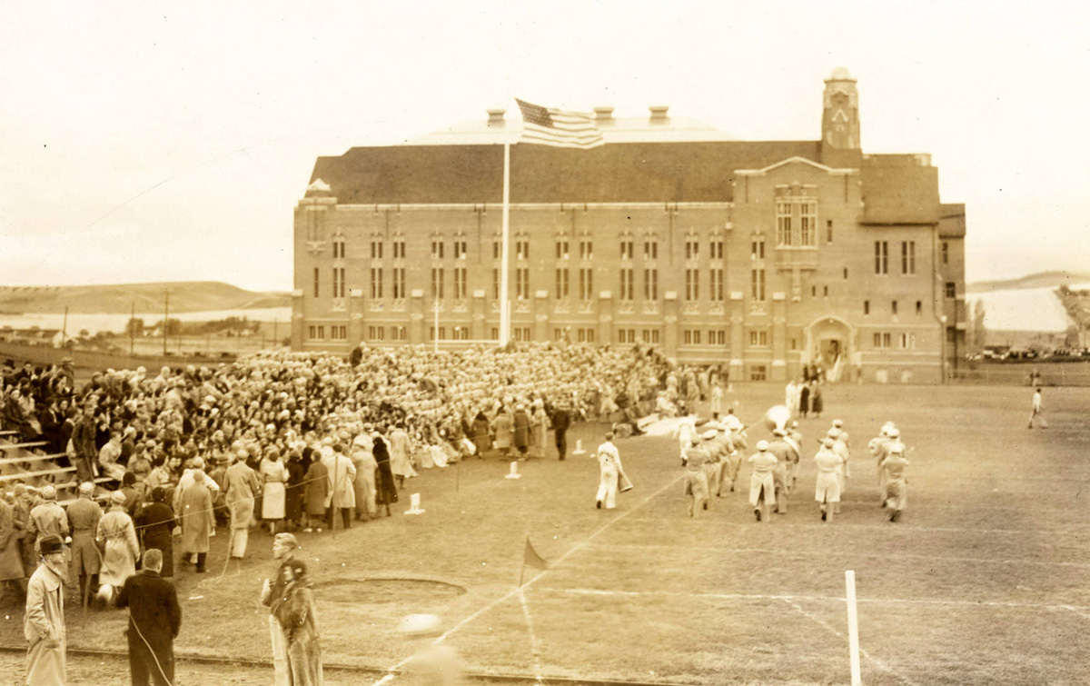 The marching band march outside the field adjacent to Memorial Gym in the 1930s.