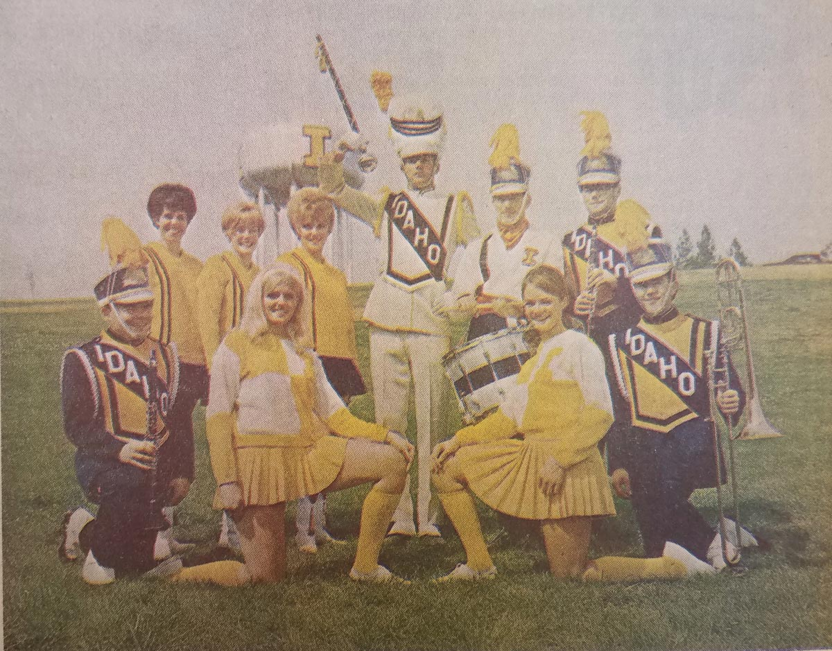 The marching band posed in a picture for Homecoming 1968