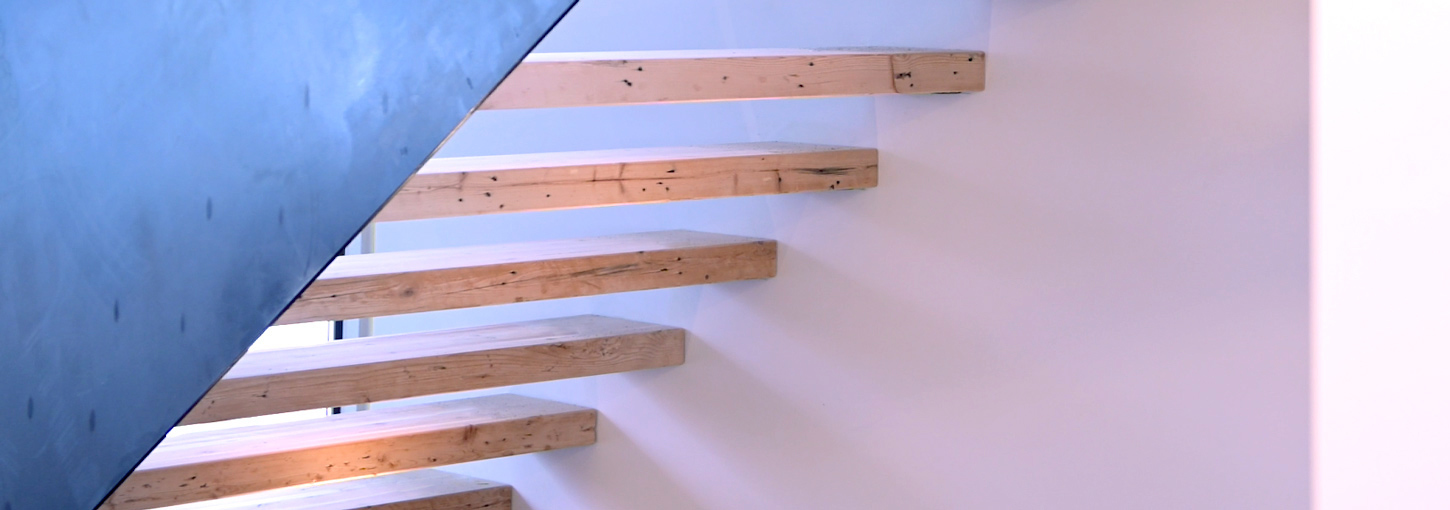 The wooden stairs at University House.