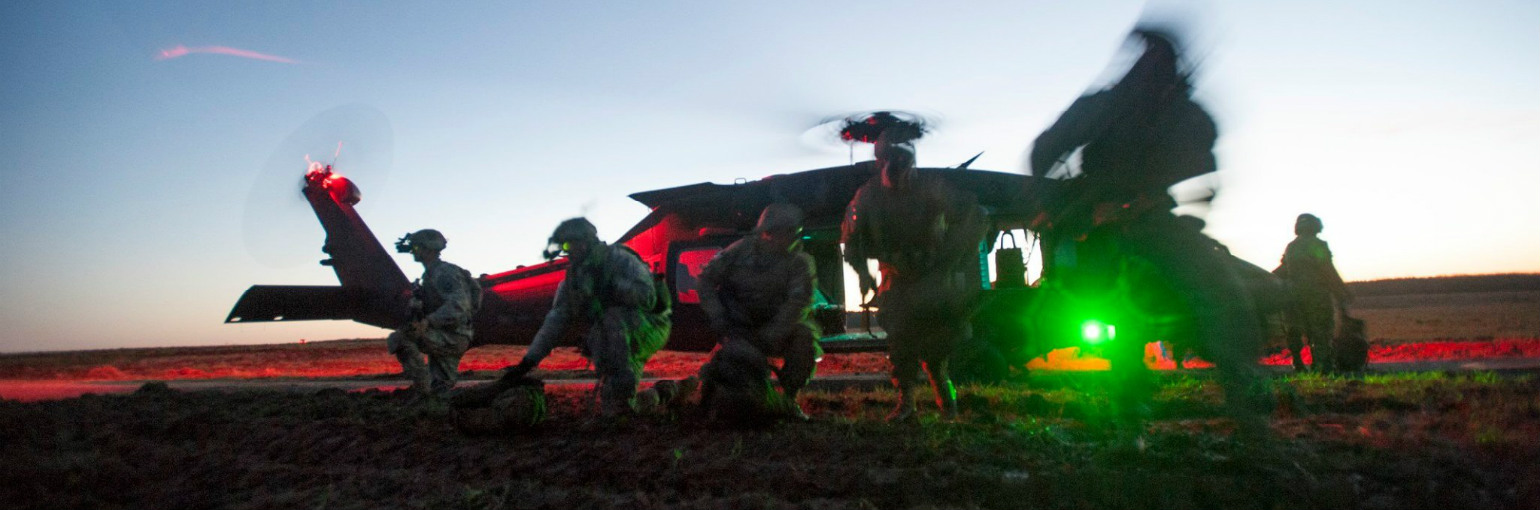 Soldiers exit a UH-60 Blackhawk.