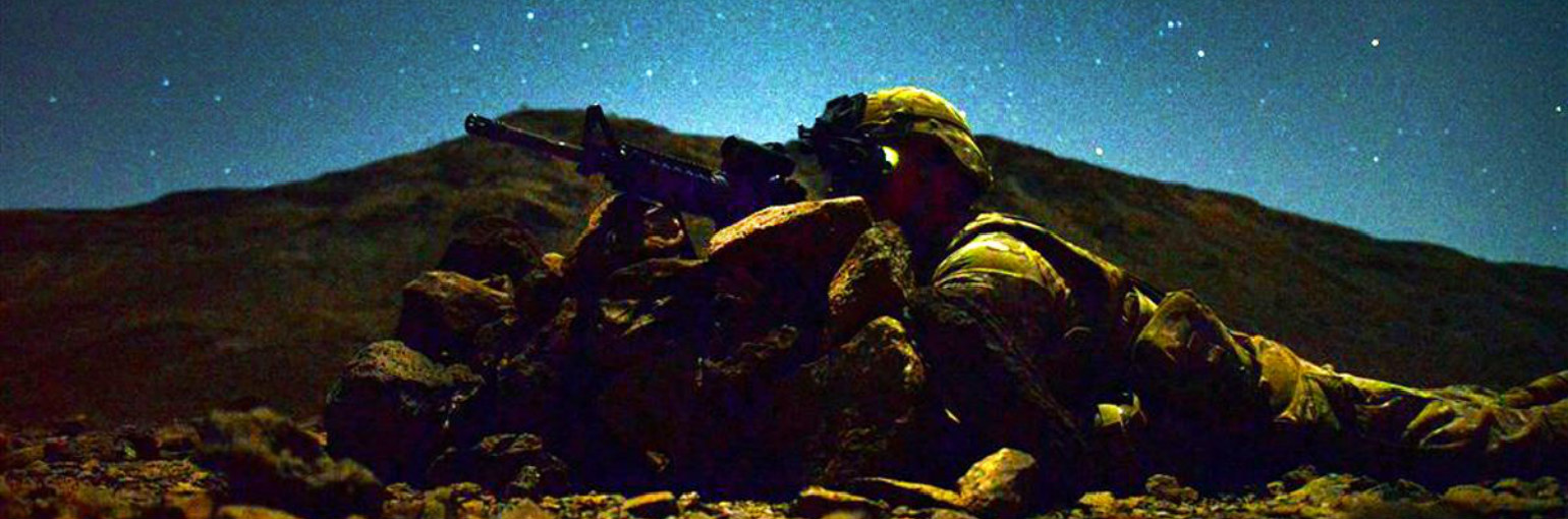 A lone Soldiers provides security in the night.