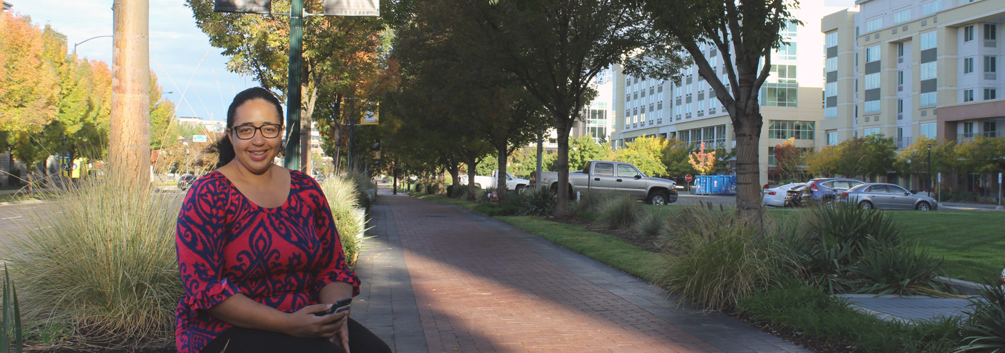 Diana Dejesus sits on a bench outside of the Boise Water Center.