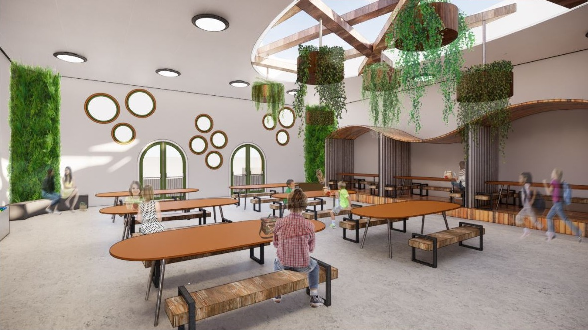 A rendering of a school cafeteria with oval tables and hanging plants.