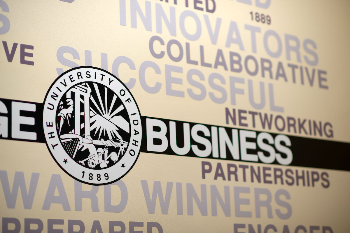 "A section of a wall mural with the U of I logo and words including ""collaborative,"" ""successful,"" ""networking"" and ""partnerships."""
