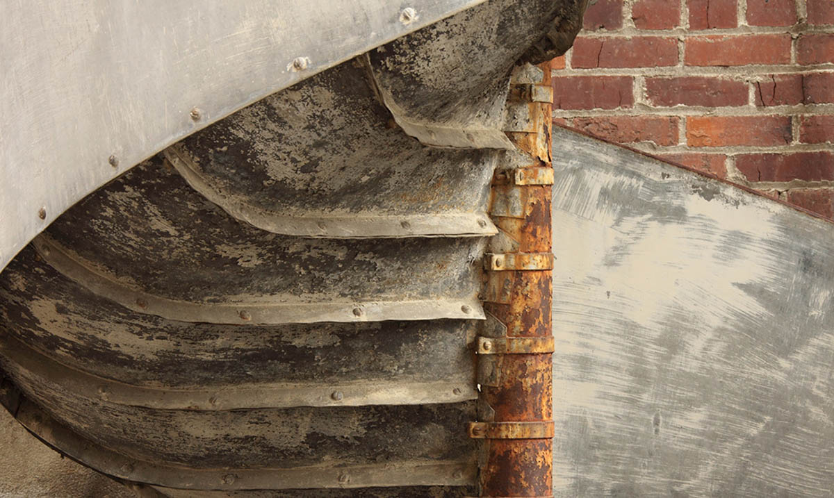 Digital photo showing a close-up of a piece of a historic fire escape.
