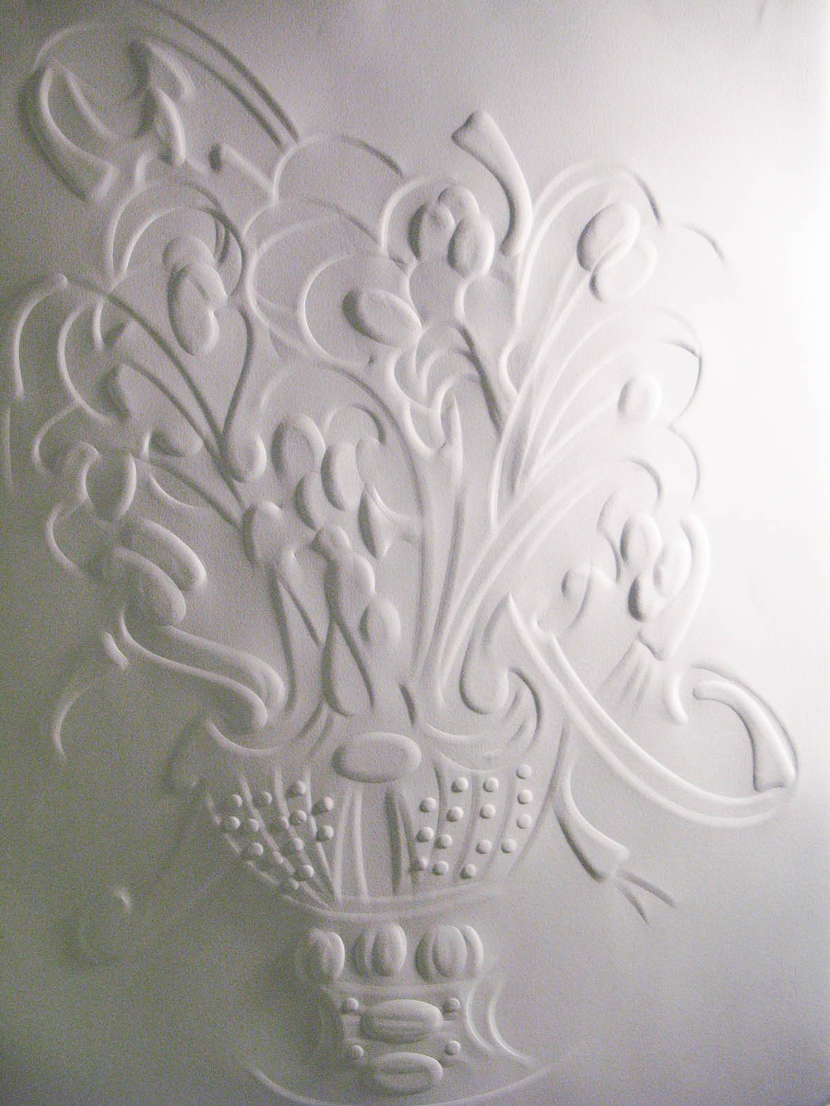 Embossed paper artwork by Andria Marcussen.