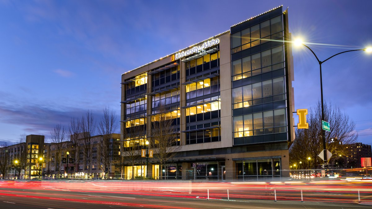 The Urban Design Center building at dusk with the University of Idaho logo on the side.