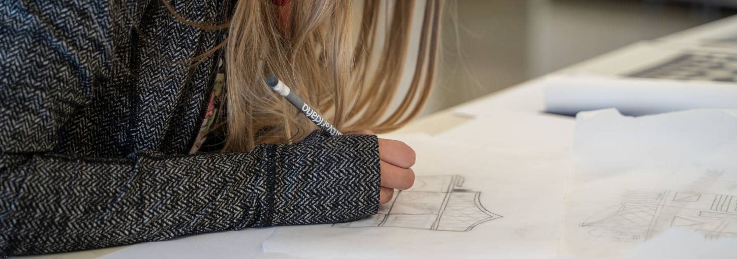 A student works on a drawing.