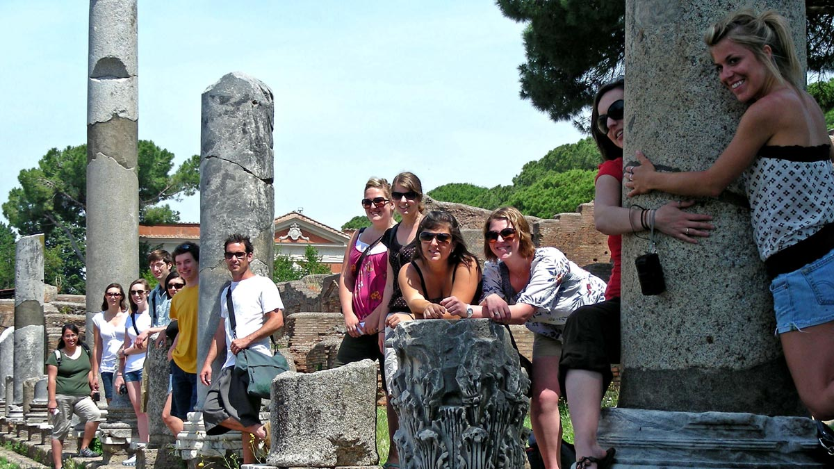 Students Pose with Ruins