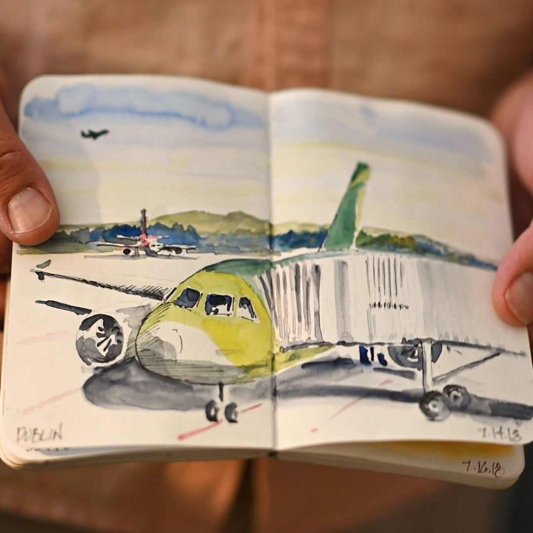 A sketch of an airplane parked at a jetway.