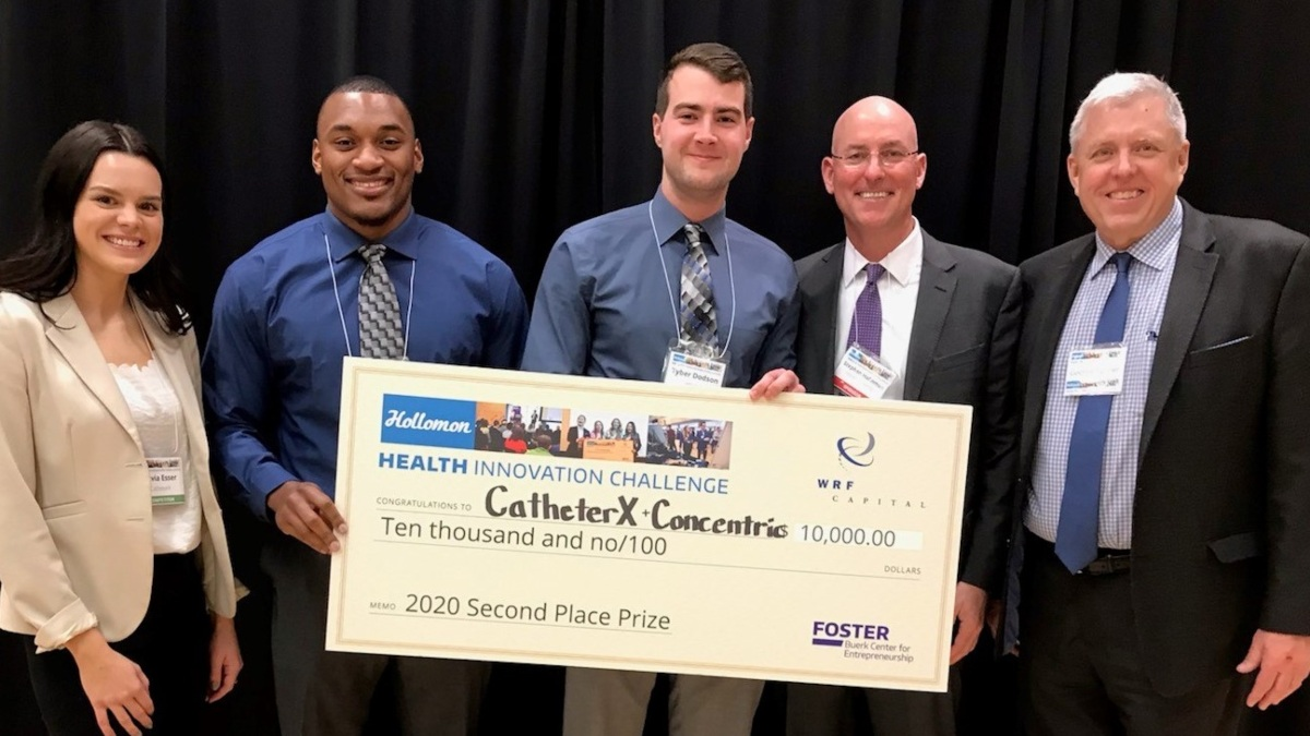 The CatheterX team poses with an oversized $10,000 check for their second place win at the Hollomon Health Innovation Challenge. With them are Stephen Hollomon, wealth management director at Merrill Lynch, and George Tanner, director of the Idaho Entrepreneurs program.