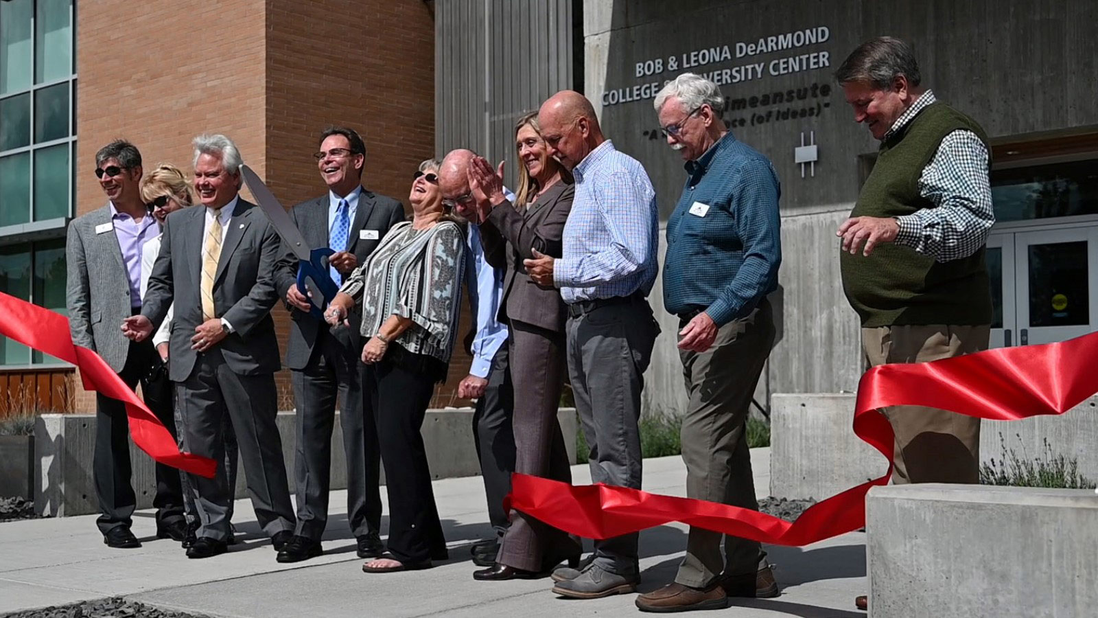U of I President Scott Green cuts the ribbon on the DeArmond Center alongside North Idaho College President Rick MacLennan, LCSC President Cynthia Pemberton and others.