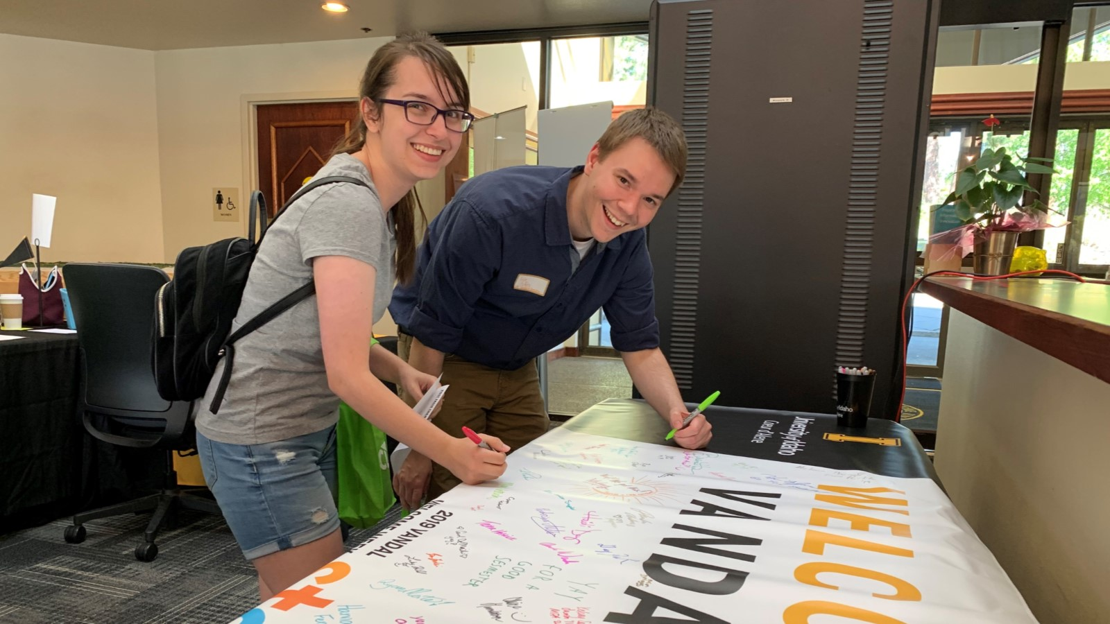 Students sign a Welcome Vandals banner