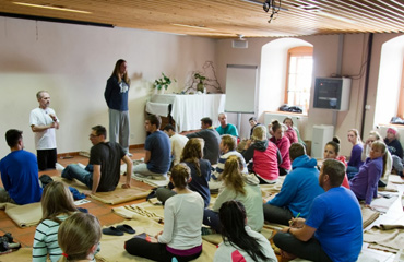 Alex Baldwin helps lead the students in restorative yoga positions inside the hospice.