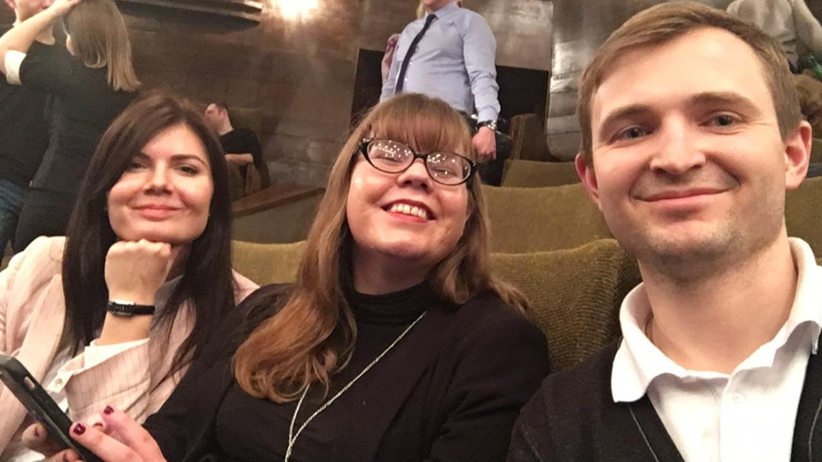 Jaime Shaffer sits with her Russian friends at the theater in Moscow, Russia