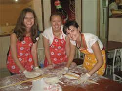 Niki Lee making gutab, a traditional Azerbaijani dish with two friends.