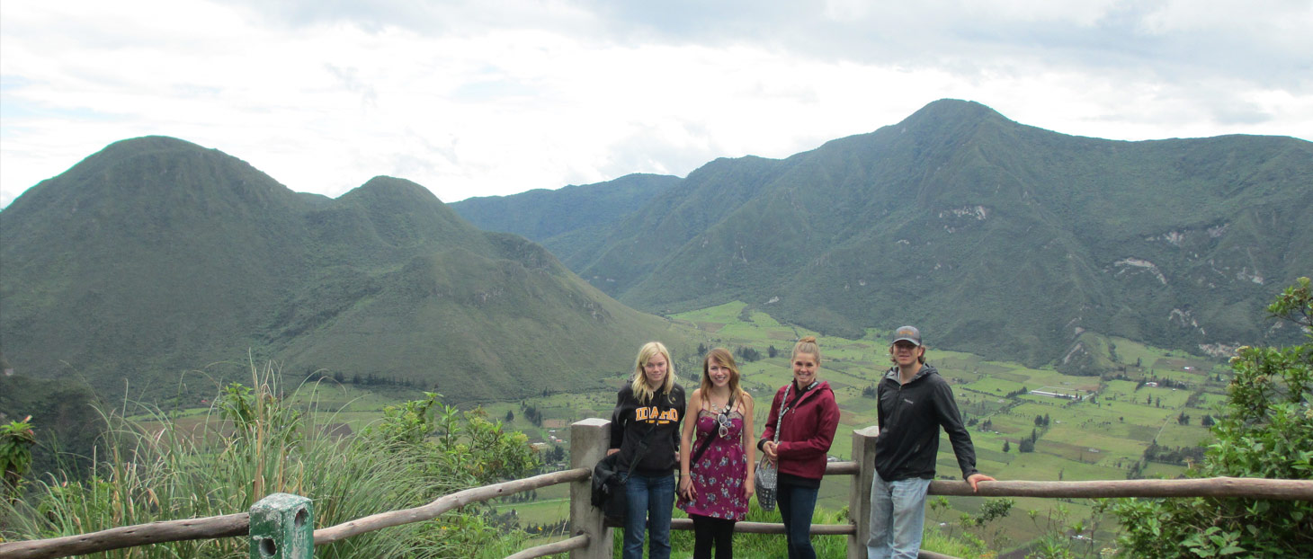 A group of students posing before the mountains in Ecuador