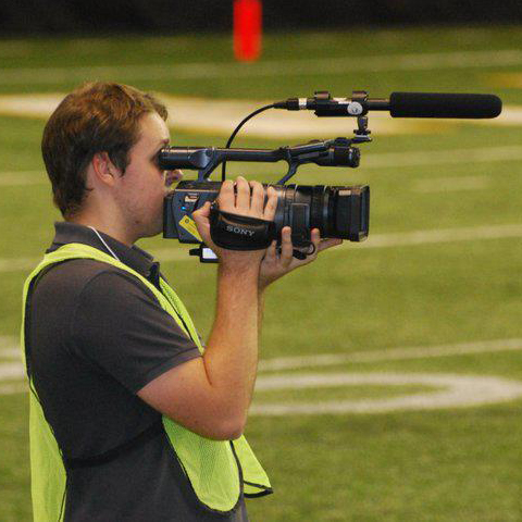 Good ol' Ilya Pinchuk with a camera on the field at the Kibbie Dome