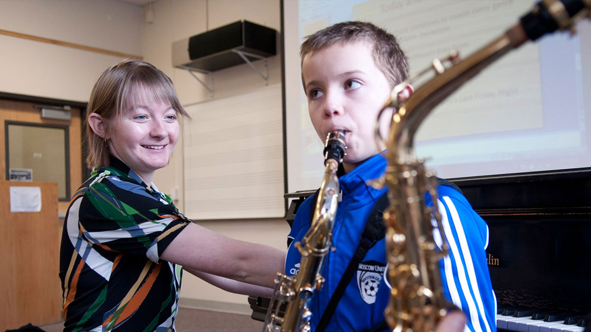 Student giving saxaphone lessons