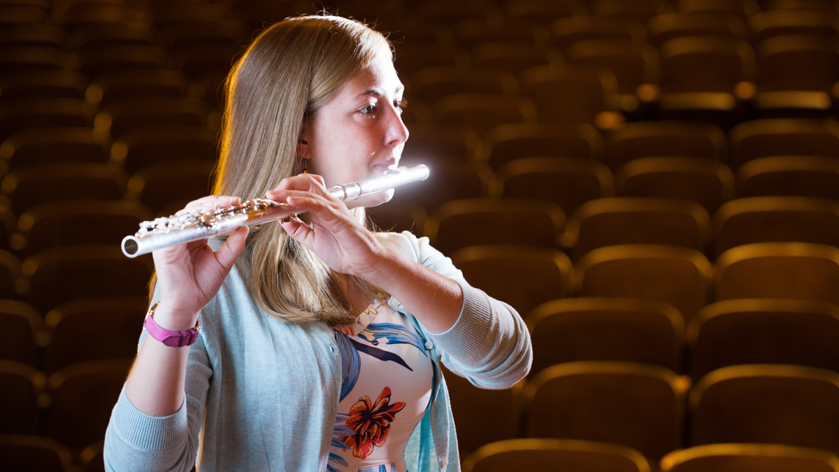 Cheyenne Kilian plays her flute during a performance in the in Haddock Auditorium.