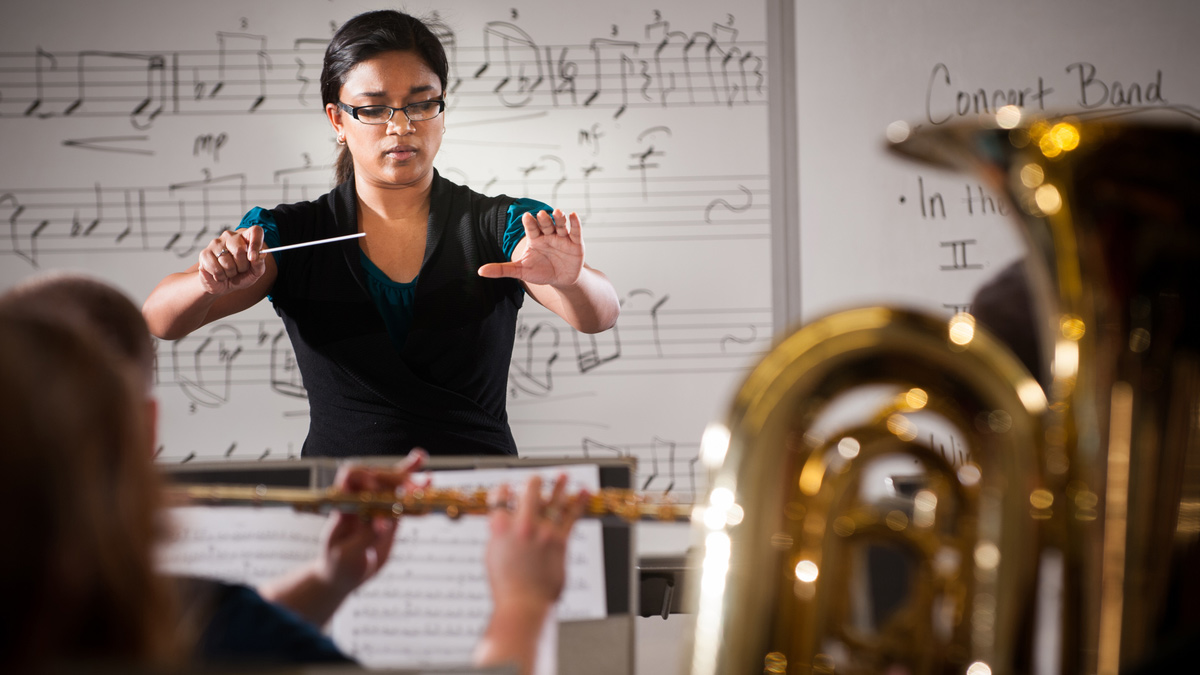 Corinne Smith conducts students at a rehearsal.