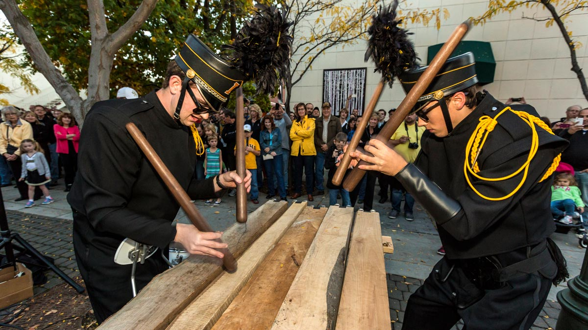 Two members of the Vandal Marching Band play the txalaparta outside of the VandalStore.