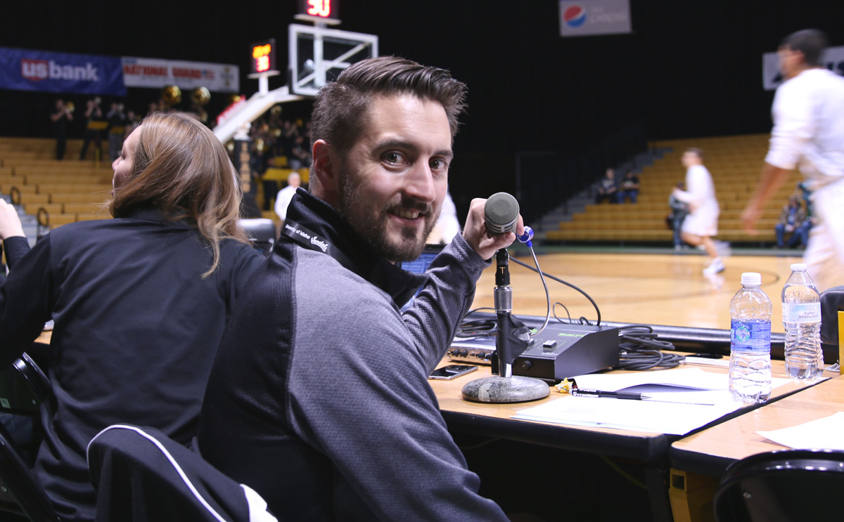 Sean McIlraith at the mic for a Vandal basketball game
