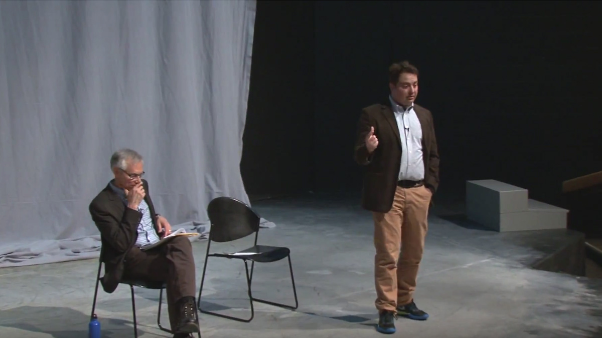 Stephen Flores and Matt Foss discussing Shakespeare on the Hartung stage.