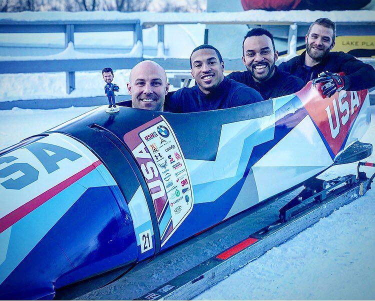 USA Olympic Bobsled team pose in sled