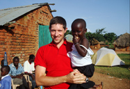 John Nuhn with little girl from his trip to east Africa.