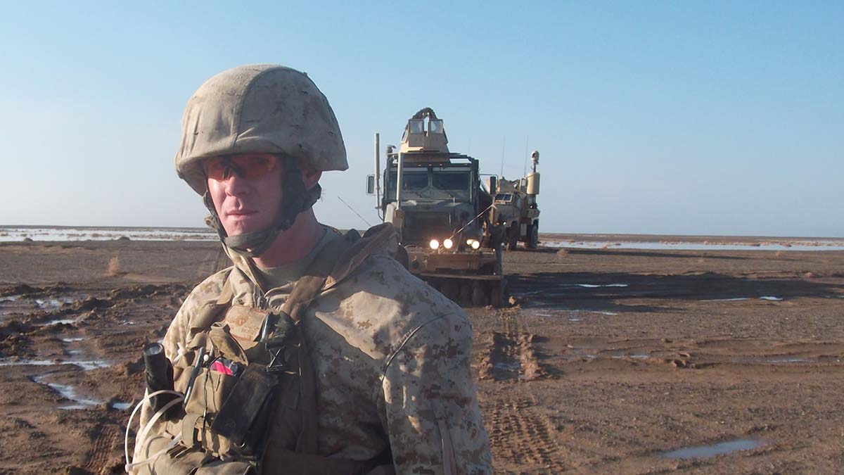 SSgt Michael Clark with a truck in the background