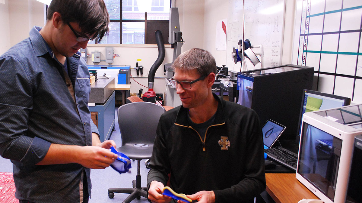 U of I mechanical engineering assistant professor Joel Perry (right) and graduate student Chris Bitikofer (left) have worked together to take feedback from area medical staff and impliment that into the new designs.