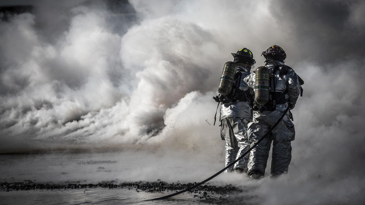 Two firefighters in smoke