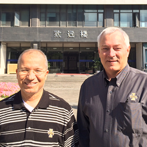 Chair Mohsen Guizani and Dean Learry Stauffer at Wenzheng College