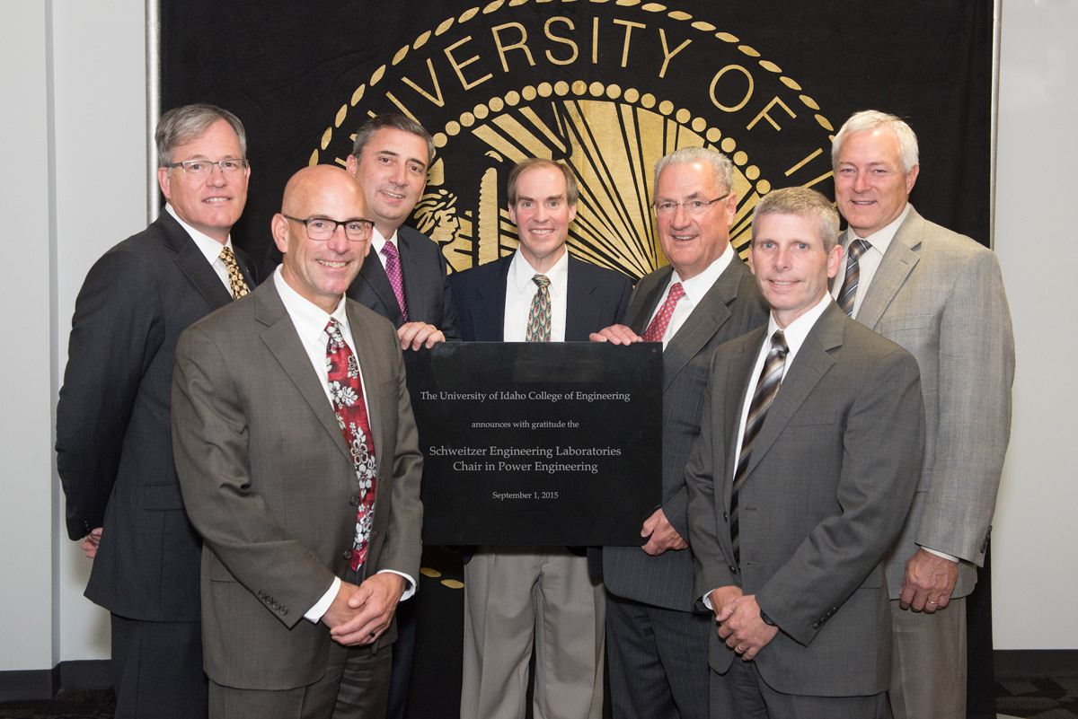 Brian Johnson with (left to right) former U of I President Chuck Staben, SEL executives Bob Morris, Luis D'Acosta, Edmund Schweitzer, Dave Whitehead and College of Engineering Dean Larry Stauffer