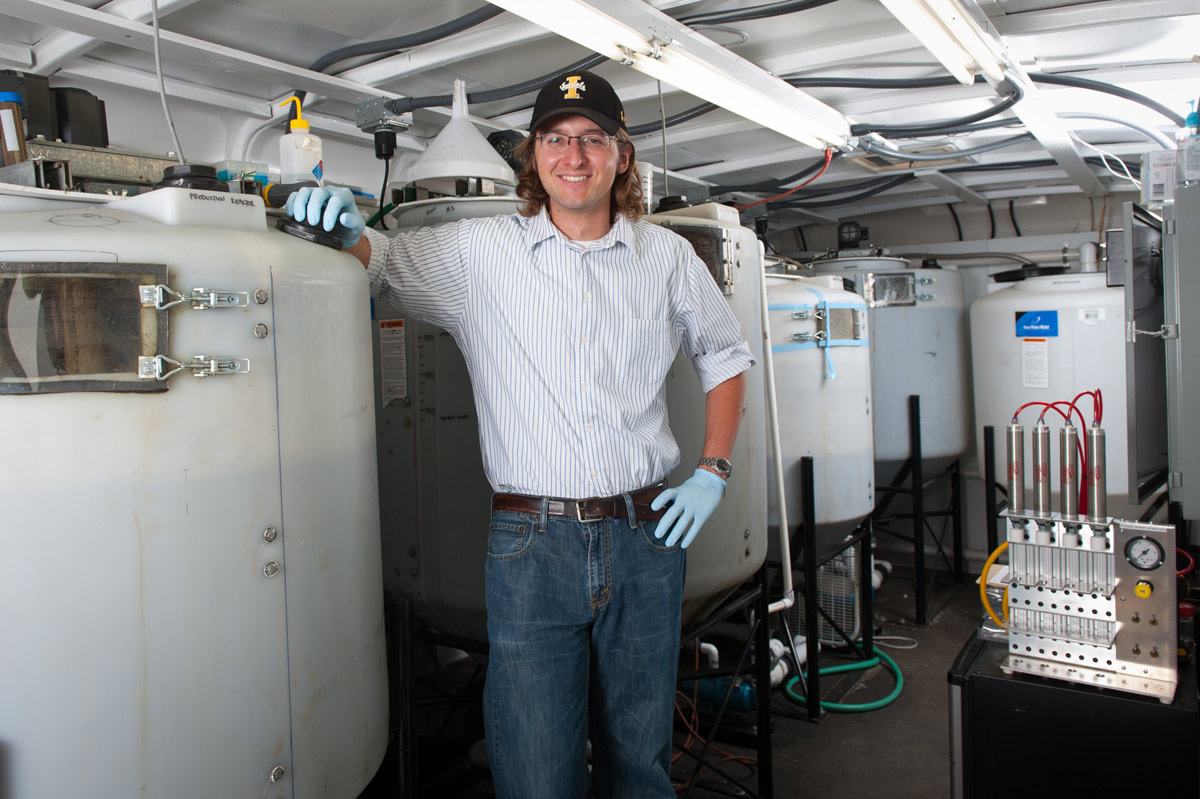 University of Idaho Civil Engineering graduate student Nick Guho in a mobile lab to convert cow manure to plastic